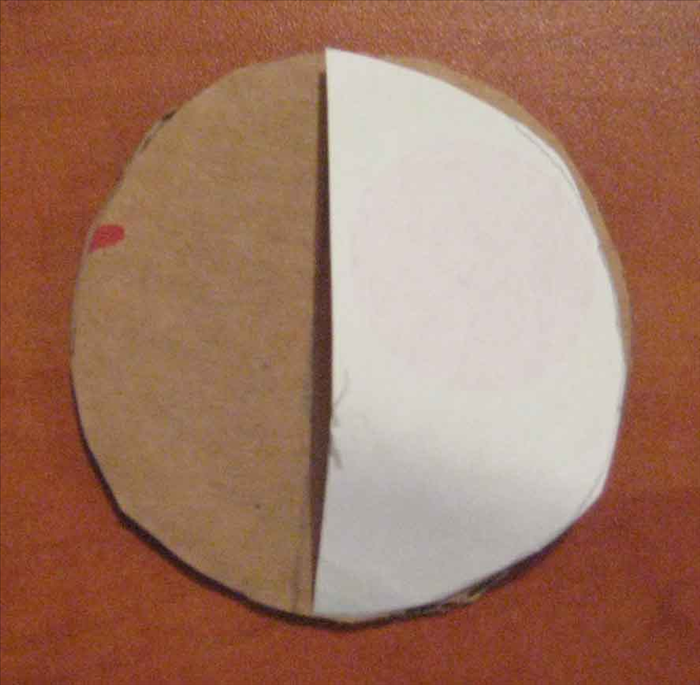 <p> Use the same circular object to trace and cut out a circle from paper. Fold the paper circle in half. Place it onto the cardboard circle and use the straight edge to mark a line going across the middle. Cut the cardboard in half.</p>