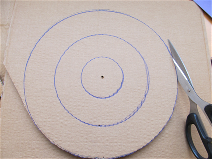 To draw circles on cardboard you will need: