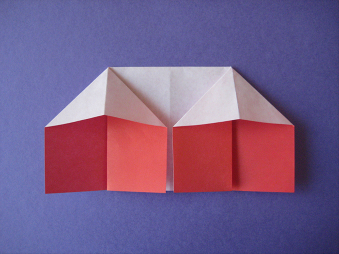 Repeat steps 6 and 7 for the left side. Your origami house is finished!
