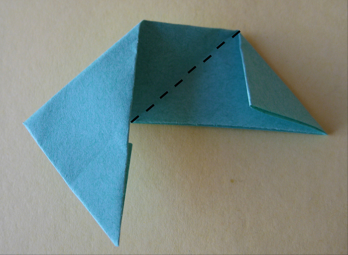<p> Fold the right side up at the center crease so that it aligns with the flap you just made.</p>