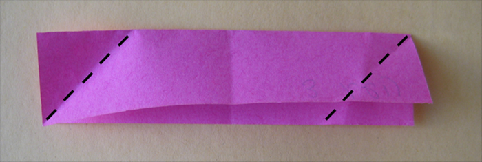 <p> Take one paper with the open side facing down. Fold the left corner down to the bottom edge. Fold the right corner up to the top edge.</p>