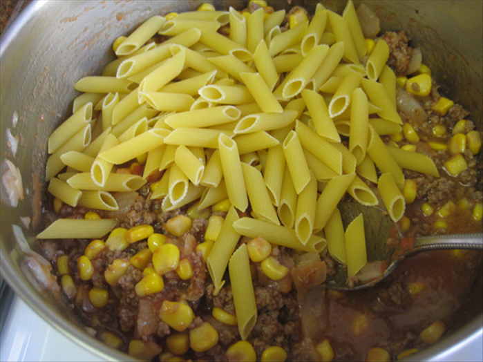 Mix in the pasta and bring to a boil Lower the heat and cook covered about 15 minutes or until the pasta is done
