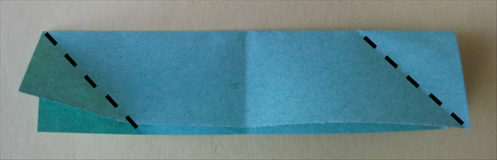<p> Take the other paper also with the open side pointing down. This time you will do the opposite. Fold the left corner up to the top edge. Fold the right corner down to the bottom edge.</p>