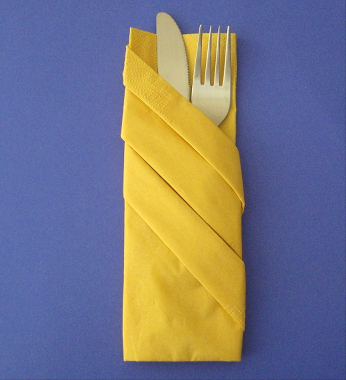 flip the napkin over for your completed napkin fold insert your silverware in the pocket