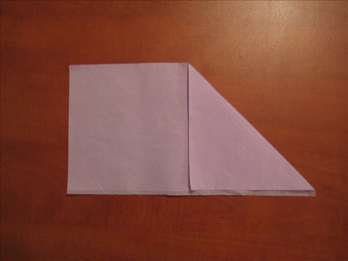 Bring the right upper corner down to the bottom  middle of the napkin.