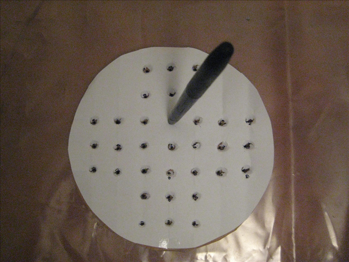 Use an old pen to punch holes through the dots.