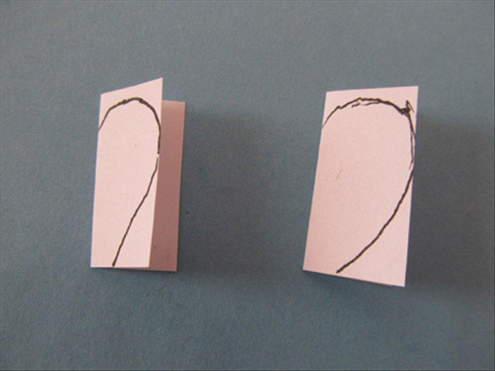 Cut a piece of scrap paper into 2 squares.