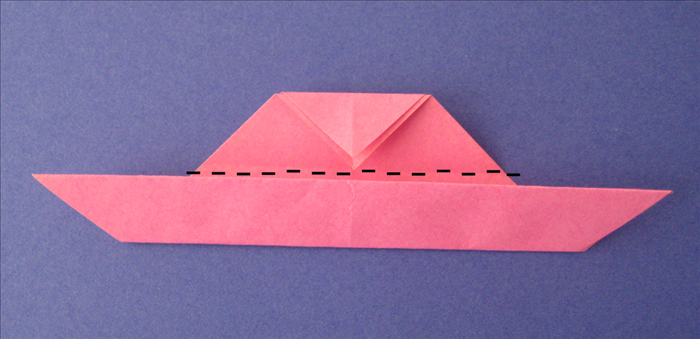 Fold the top down along the edge of the flap