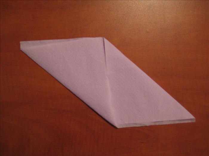Bring the bottom left corner up to the middle of the top of the napkin