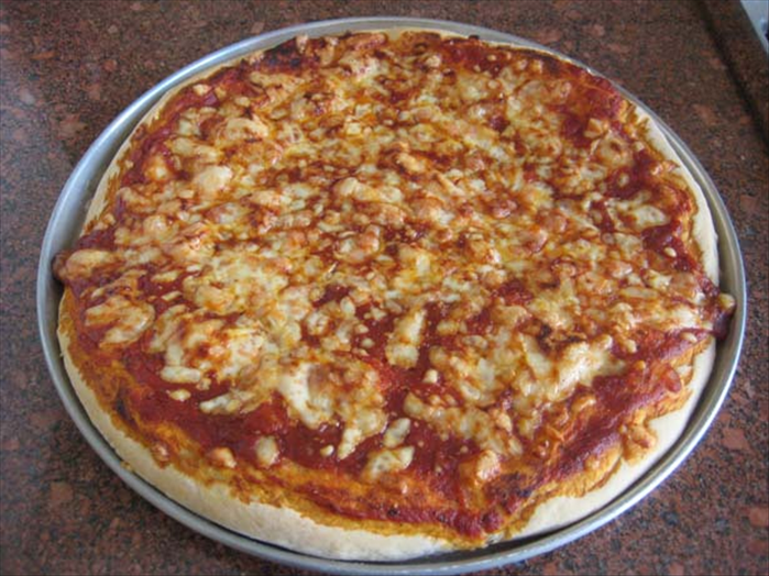 Ingredients for 2 large pizza pies : 1 medium onion chopped 2 cloves garlic crushed 1 tablespoon chopped fresh basil leaves or ½ teaspoon dried basil  1 ½ teaspoons fresh oregano or ½ teaspoon dried oregano ¼ teaspoon black pepper 1 medium can tomato paste 2 cups shredded cheese – mozzarella is best but yellow cheese will do ¼ cup parmesan cheese – optional  For dough: 1 package dried active yeast ¾ cup warm water ½ teaspoon salt ½ teaspoon sugar 2 tablespoons olive oil  or vegetable oil 2 cups flour