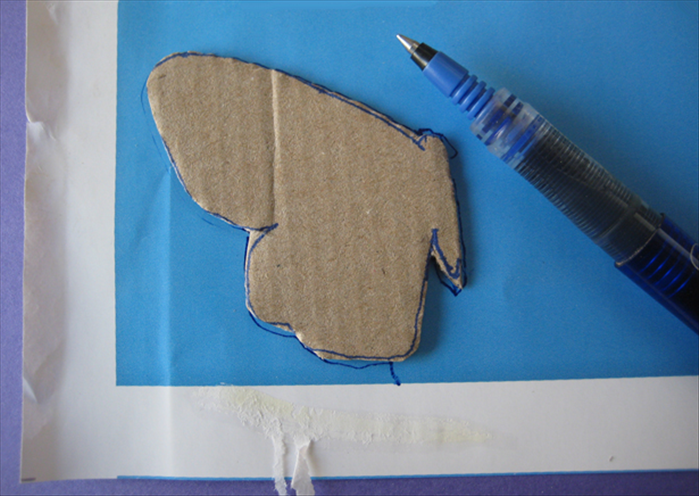 Cut out the cardboard shape.