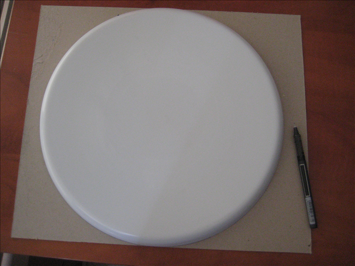 Place a large round serving tray on the cardboard and make an outline around  it.   Cut out the circle. Repeat for a large plate and a small plate