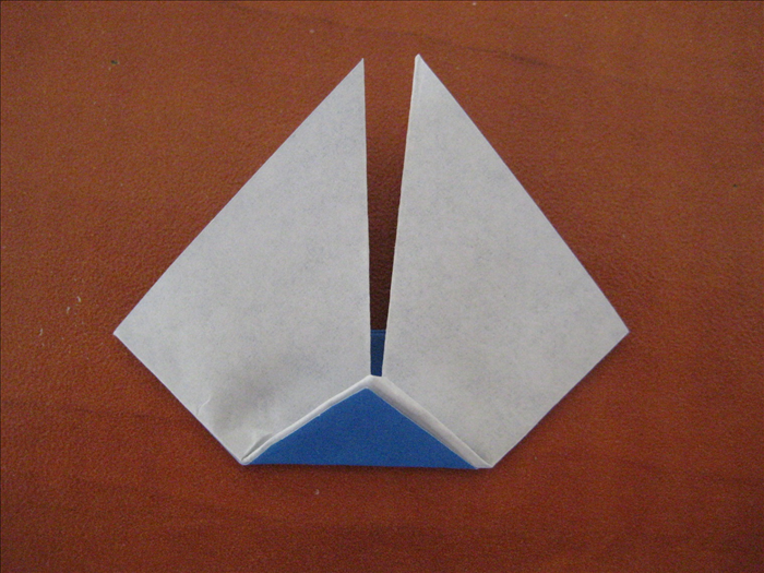 Fold the bottom point up to center