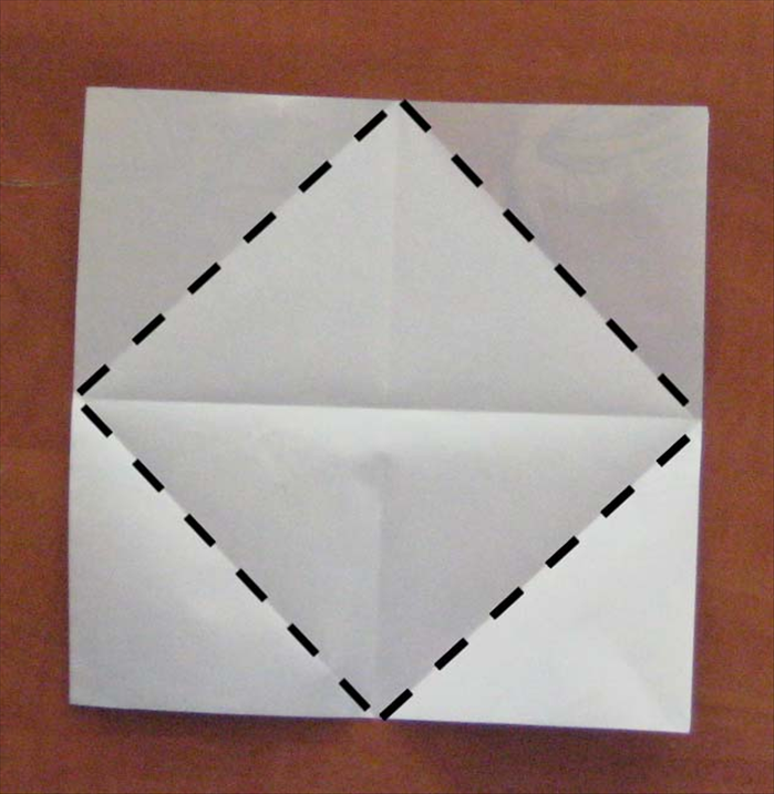 Fold the 4 corner points to the center.