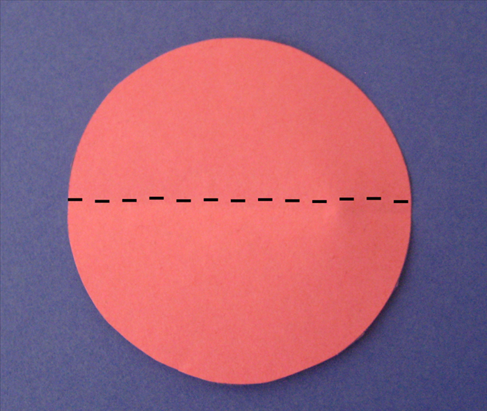Fold the large circle in half.