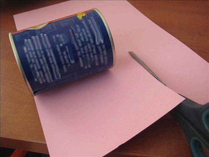 Cut paper  about 1 ½ inches  bigger than the height of 2 cans and long enough to go around