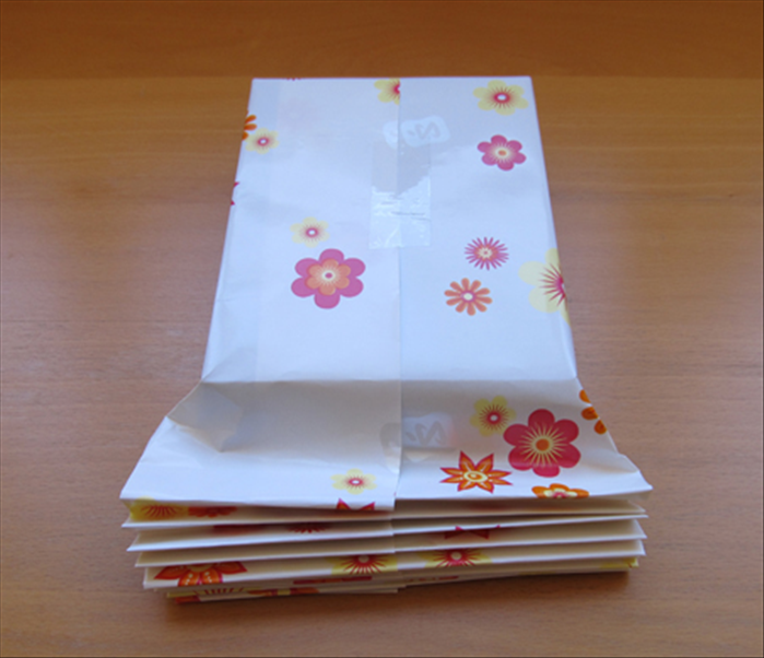 Fold the accordion fold until you have reached the top of the gift.