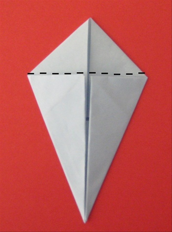 Fold the top smaller double triangle backwards- behind