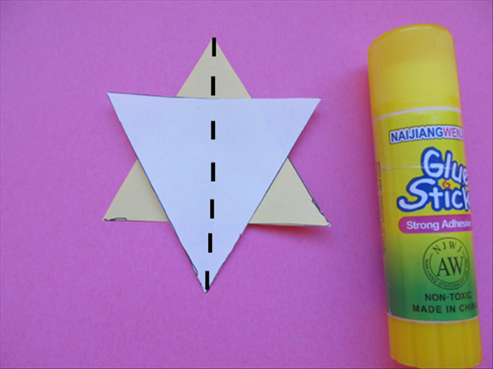 <p> Glue the triangles together to make a star.</p>  <p> Fold the star in half vertically as shown</p>