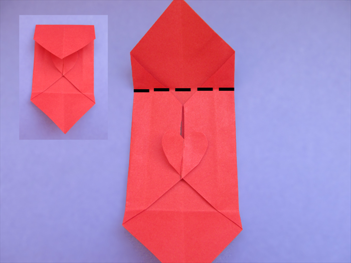 Fold the top point down to the bottom of the heart Crease and unfold