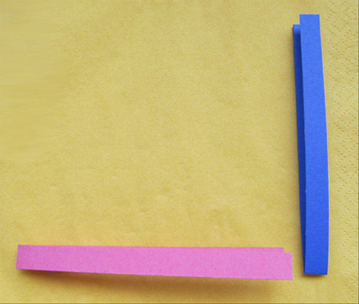 Fold the 2 strips in half.