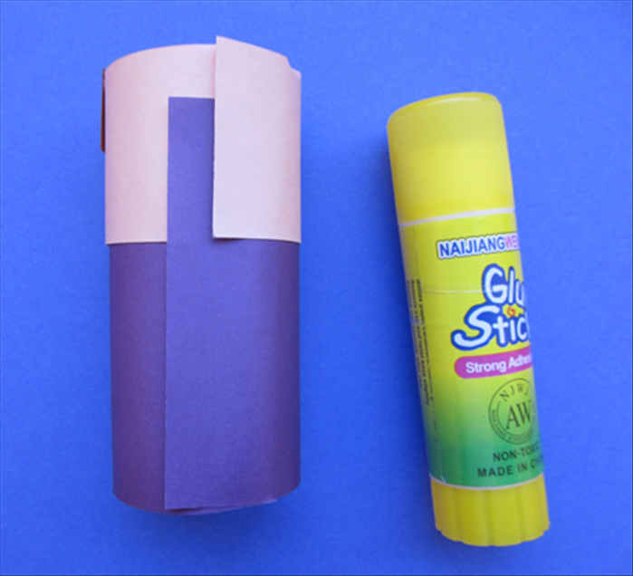 Wrap the base around the toilet paper roll and glue the ends together