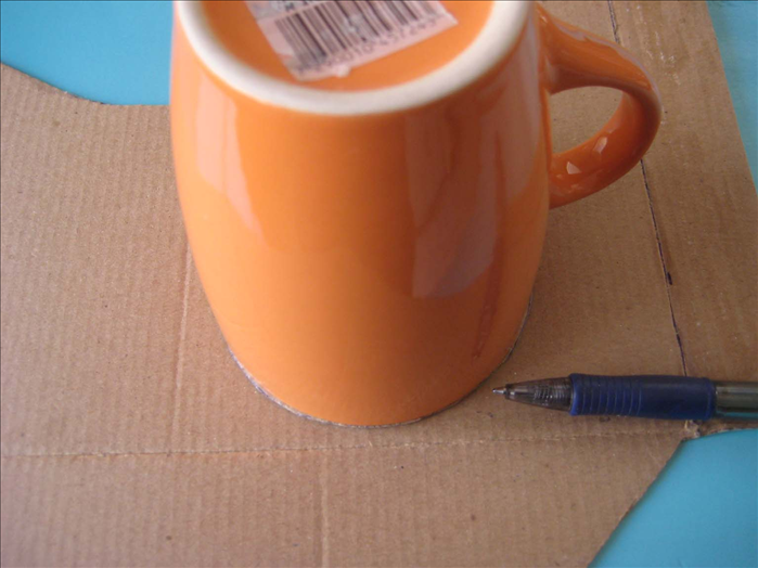 Find an object that is a tiny bit bigger than the circle you just traced and trace around it on the cardboard.