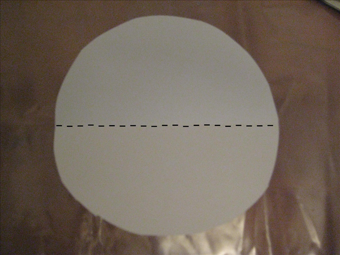Trace and cut out another circle on a piece of scrap paper  