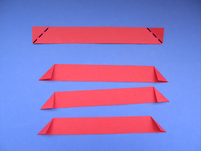 <p> Carefully fold down the top points of the strips to align with the bottom edge. &nbsp;</p>  <p> *Make sure the bottom of the crease starts at the corner.</p>   <p> &nbsp;</p>