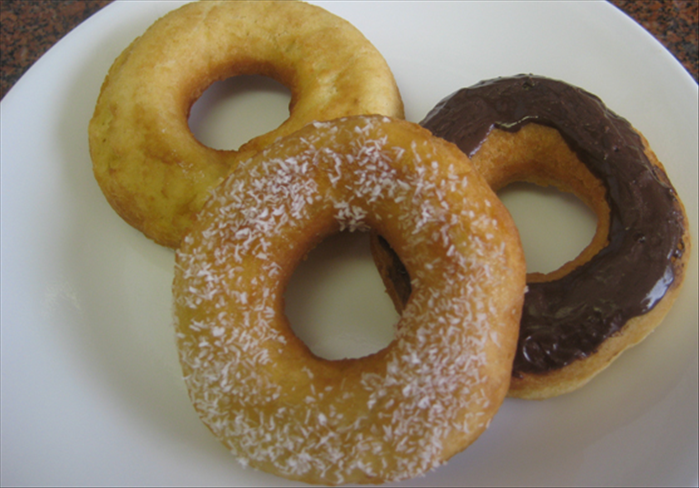 Flip over the doughnuts and fry the other side until light brown .