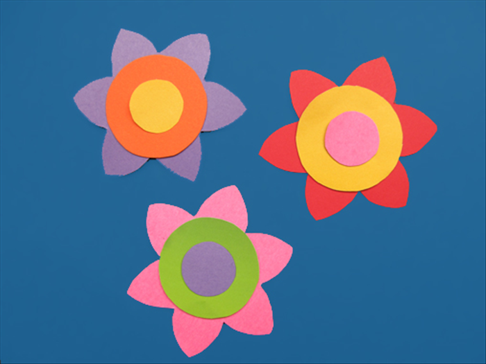 Here are some examples of the flowers with the circles glue to the center.  You can make flowers of different sizes and place them on top of each other with the largest one on the bottom and smallest on top.   Have fun experimenting and creating!
