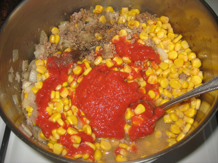 Add the salt and pepper, soy sauce, tomato paste and corn- that includes the liquid from the corn can Mix well