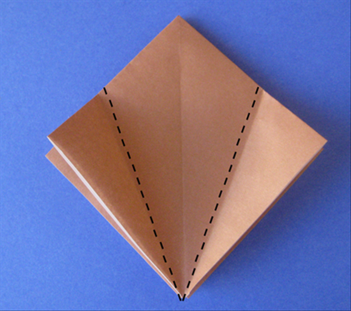 This model begins with the square base. See the instructions for folding a square base if you do not know how to do it.  Place your square base with open side on the bottom. Fold the side points up to the center crease.