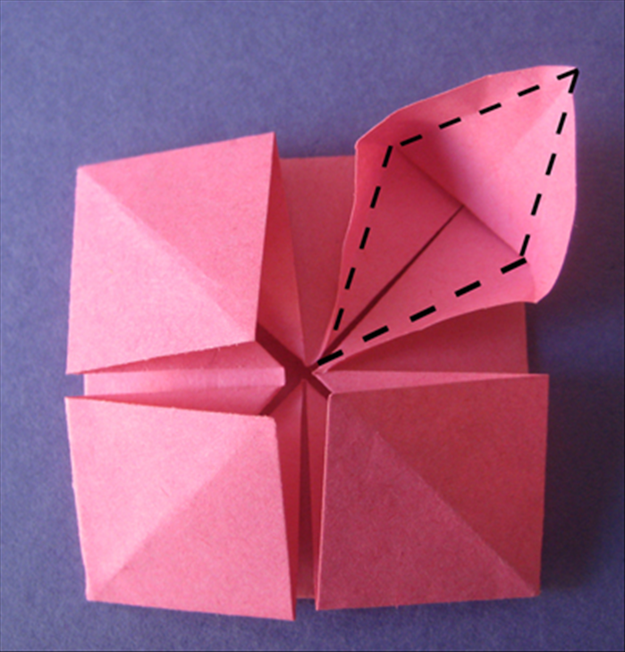 Lift up the flap to the crease you just made.  Fold the edges to the center along the crease lines.  Repeat steps 11 and 12  for the other 3 sides.