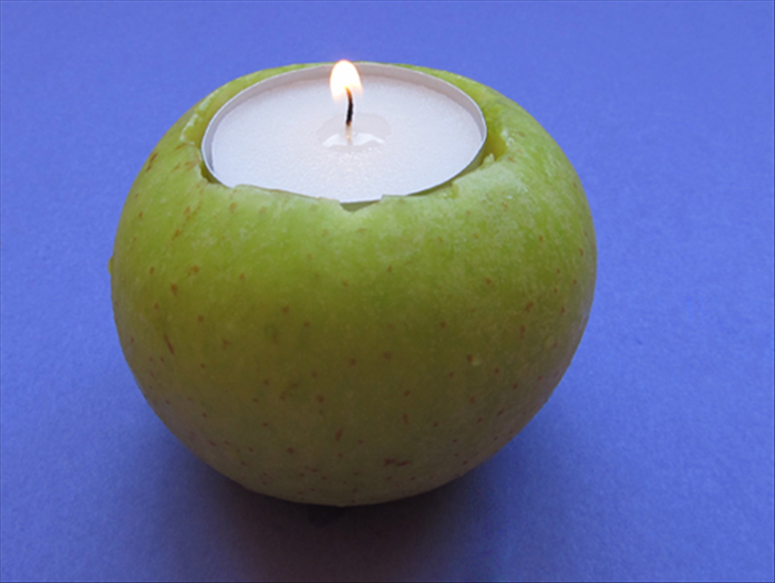 Place the apple candle holders on the table and light them just before your guests arrive.  Happy Holiday!