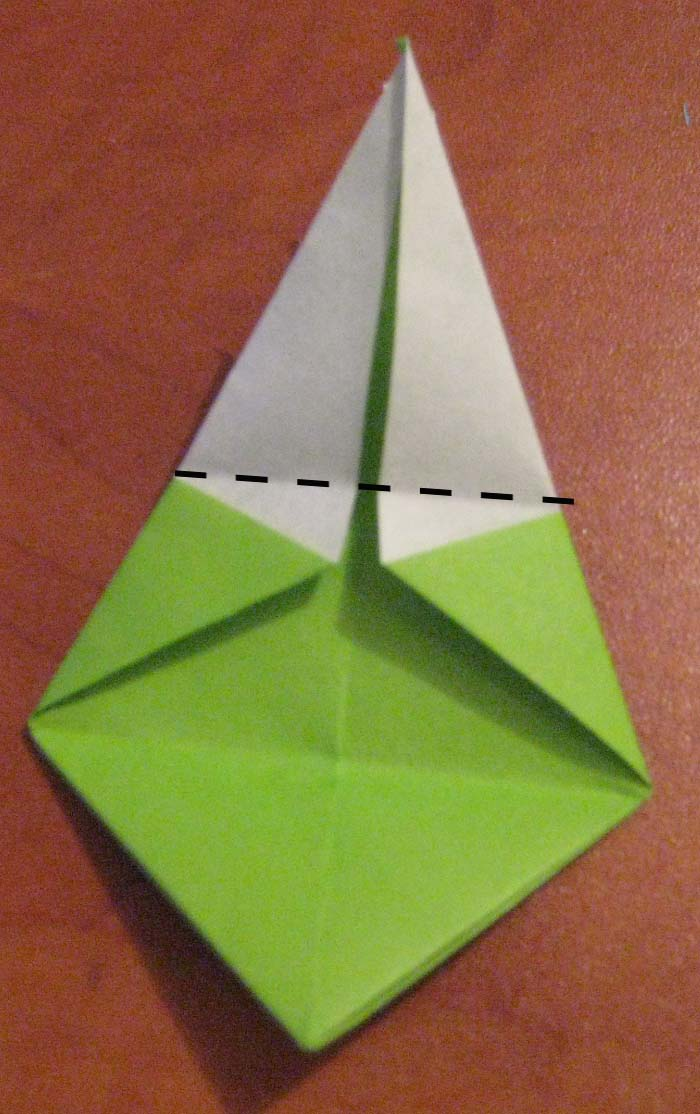 Bring the top point down to the bottom to fold in half.
