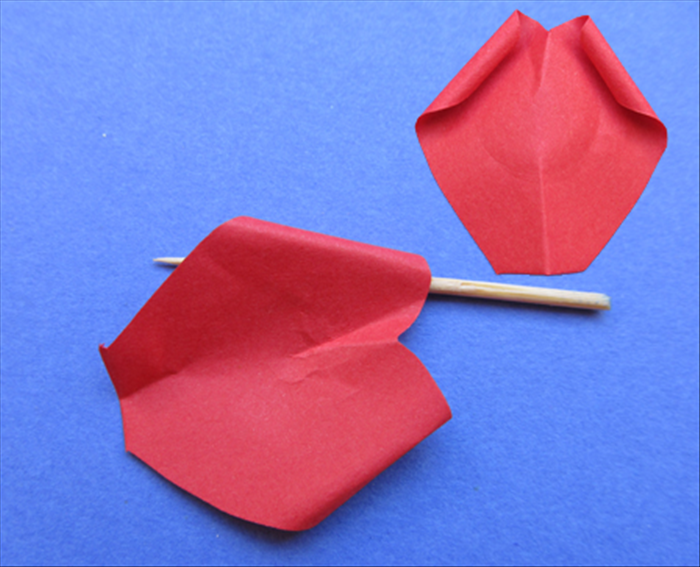 Pinch the straight bottom of the petal.