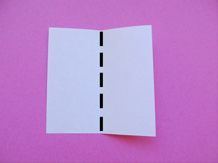 <p> Fold one of the small square papers in half vertically</p>