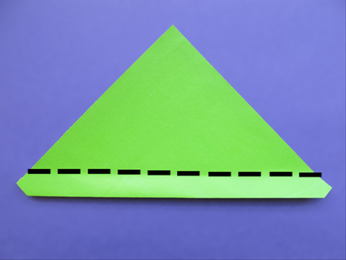 Flip the paper over to the back side Make a fold slightly above the side points. See the next picture for the result