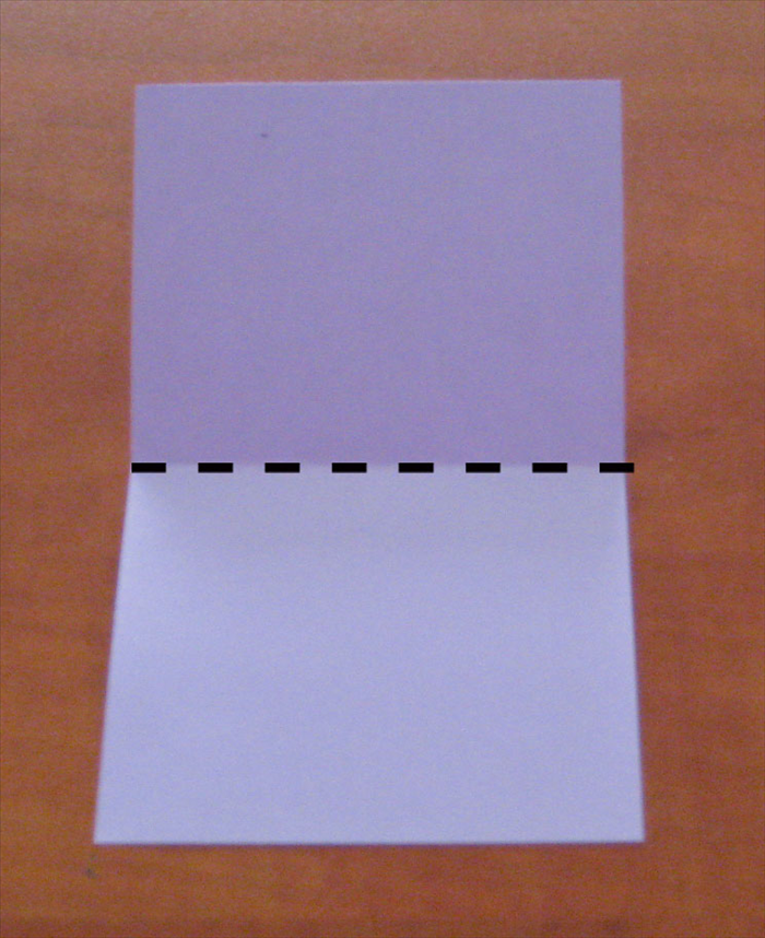 Place the paper with the short ends at the top and bottom. Bring the top edge down to the bottom to fold in half.