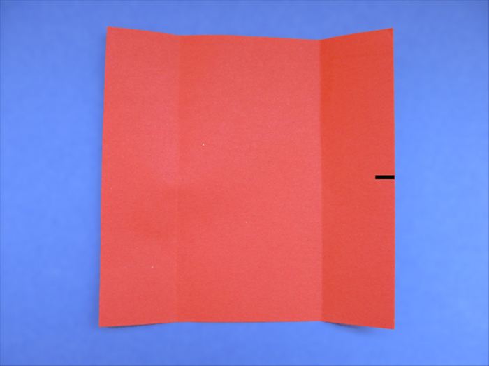 <p> Bring the bottom edge up to the top edge as if you are going to fold it in half. Do not crease just make a pinch mark at the edge.</p>   <p>  </p>