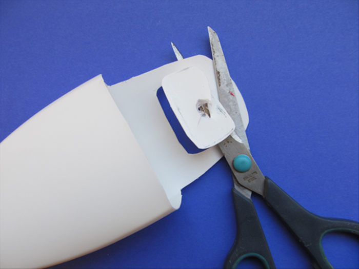 Use the hole as an entrance point for your scissors. Cut a little outside the line you traced.