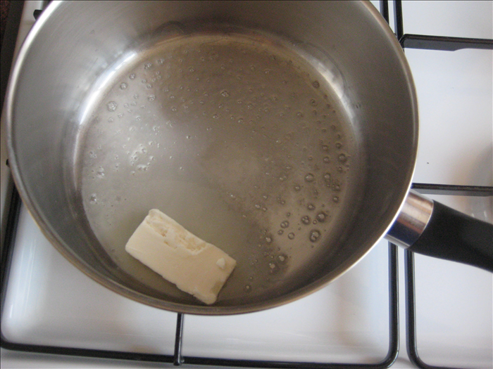 Melt the butter or margarine in a pot over low heat