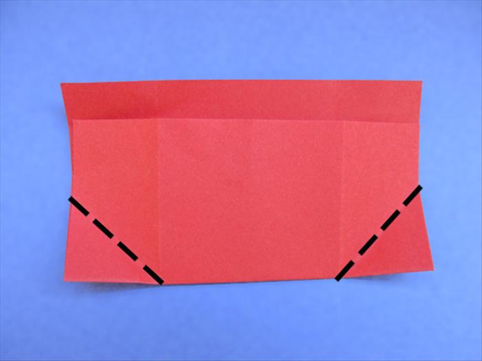 <p> Rotate the paper so that the folded edge is on the bottom.</p>  <p> Fold the bottom corner to align with the creases.</p>