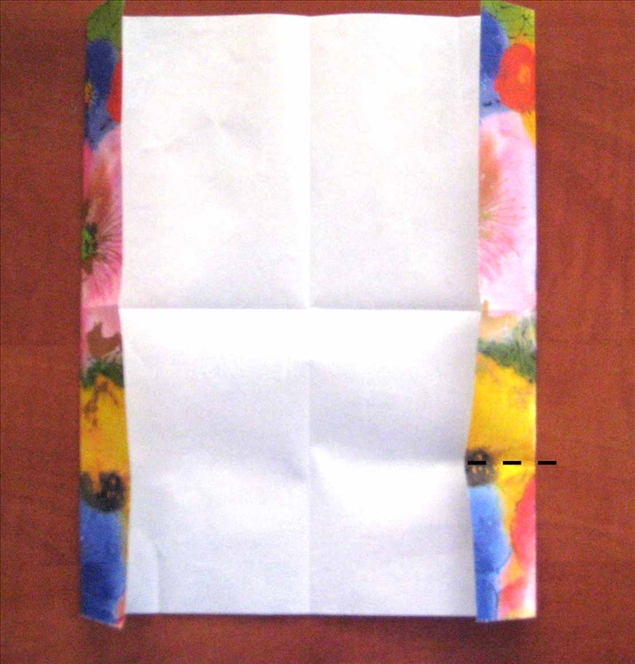 Rotate the paper so that the folded edges are on the sides.