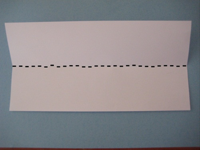 Place the paper with the short ends at the sides.  Fold it in half horizontally.  Unfold.