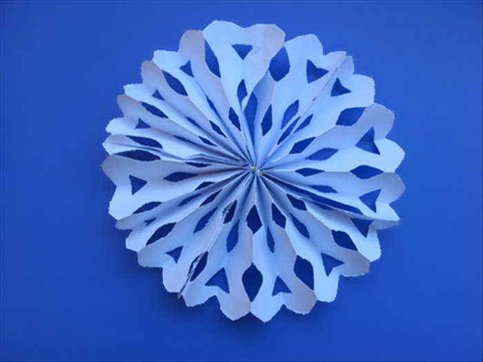 Your snowflake fan decoration is ready to hang Have fun experimenting with different cuts!