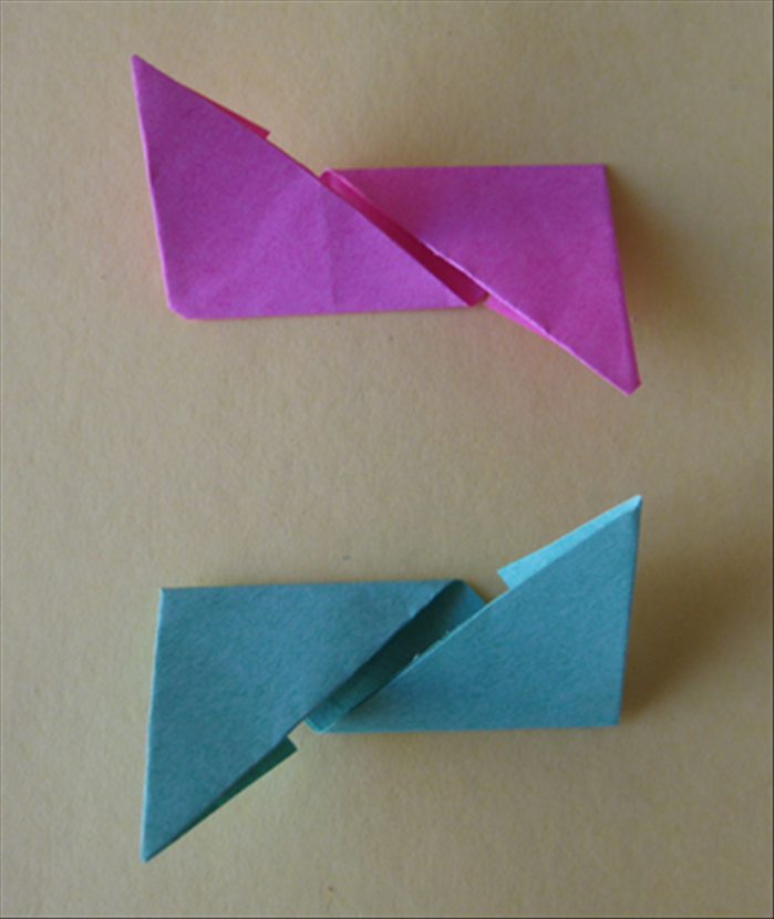 <p> You should have the 2 papers folded in the opposite directions as shown in the picture.</p>