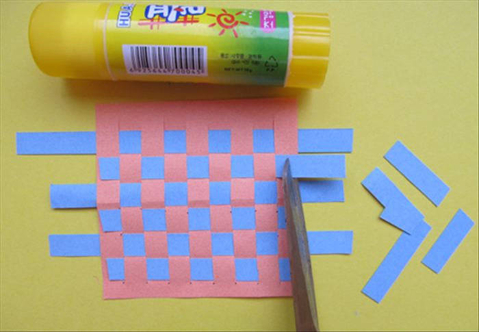 Cut the strips that end in front along the edge.