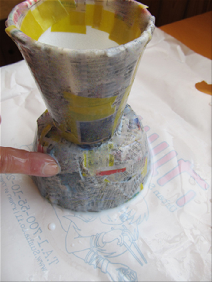 Put at least another 2 layers of strips on the vase.